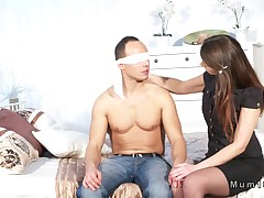Milf sucks dick to blindfolded guy in bedroom