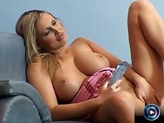 Footage of Mandy Bright having fun of her huge dildo