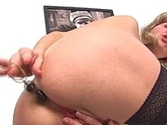 This older slut likes toys up her slit and arse