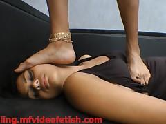 Brunette Girl Trampling Hard Slave Girl Face and Body