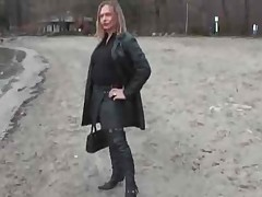 Leather wench with buttplug outside