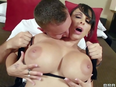 Holly Halston is a gorgeous milf with massive melons. Her perfect monster tits turn him on and he pulls out his stiff cock. She sucks his cock and he plays with her gigantic boobs
