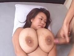 Fucking her gigantic Japanese tits