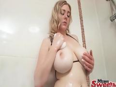 Bikini girl fondles her incredible big breasts