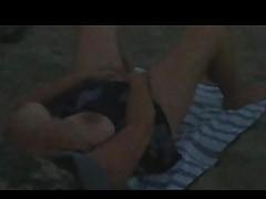 caught woman masturbatie on beach